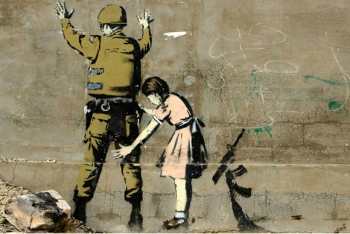 Girl and a Soldier graffiti by Banksy on the West Bank in Bethlehem