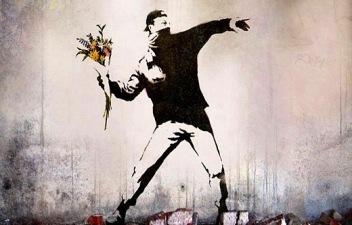 """Rage, Flower Thrower"" graffiti on a Jerusalem wall by the artist Banksy"