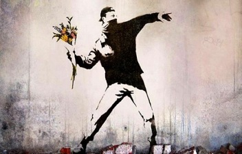 """Rage, Flower Thrower"" graffiti on a Jerusalem wall by the artist Banksy"