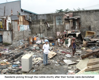 residents picking through slum demolition rubble in manila