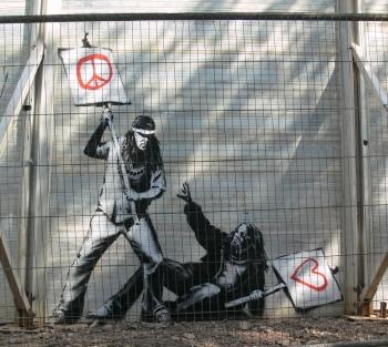 banksy peace versus love