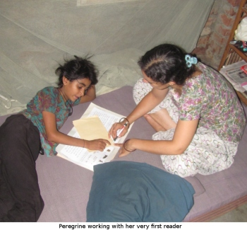 Peregrine working with her first reader in the slum