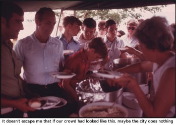 MINERS AND THEIR FAMILIES PASS THROUGH A FOOD TENT WHICH FEATURED BARBECUE AND COMPLEMENTS AT THE TENNESSEE CONSOLIDATED COAL COMPANY FIRST ANNUAL PICNIC AT THE TENNESSEE VALLEY AUTHORITY LAKE NEAR JASPER AND CHATTANOOGA, TENNESSEE. MINERS AND THEIR FAMILIES GATHERED TO TALK, PARTICIPATE IN SPORTS, WATCH A GREASED PIG CONTEST, AND HEAR ABOUT THE COMPANY'S HEALTH AND RETIREMENT BENEFITS