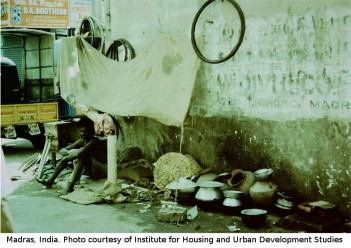 Photo of man in a Madras slum in the 1980s by Pál Baross. Photo courtesy of the Institute for Housing and Urban Development Studies