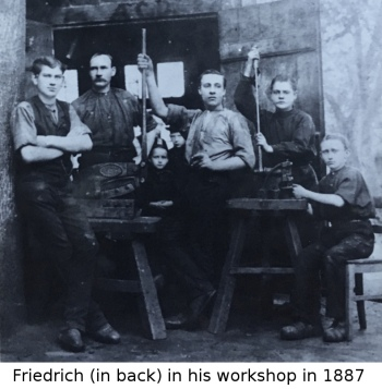 Friedrich, a German immigrant, in his workshop in 1887 with his children in the background
