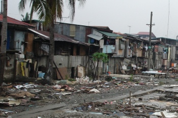 slum homes in manila after demolition